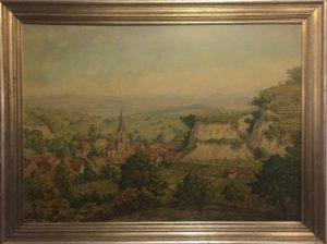 """A painting in the """"Zum Roten Bären"""" shows a view of Freiburg im Breisgau. On the right side: Schlossberg with """"Kanonenplatz"""". © 2017, Münzenberg Media, Photo: Stefan Pribnow"""